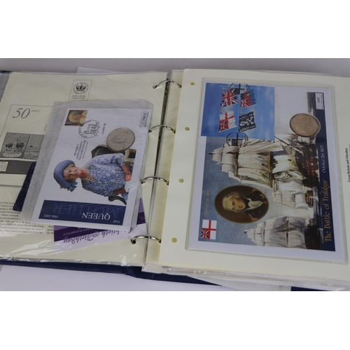 537 - A collection of Westminster Mint commemorative £5 and crown coin stamp covers contains within an alb...