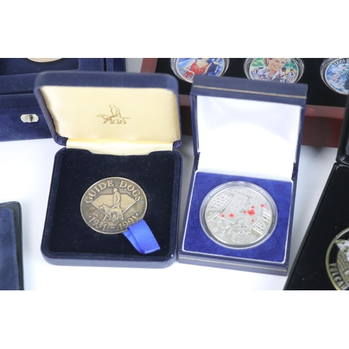 543 - A collection of commemorative coins and medallions to include 2014 D-Day enamel crown, the princess ...