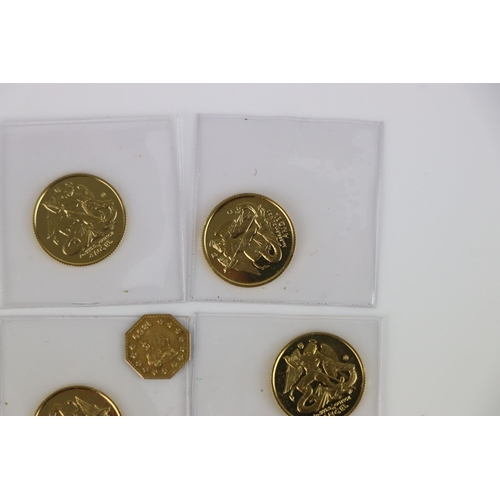 547 - A small collection of British gold coins to include California gold rush 1/4 dollar and an Isle of m...