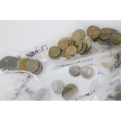 548 - A collection of foreign coins to include European and worldwide together with a small group of bankn...