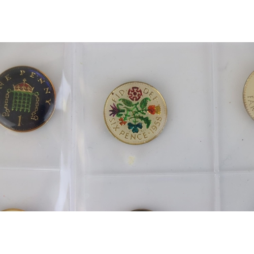 552 - A collection of twelve enamelled British coins, eleven being enamelled both sides.