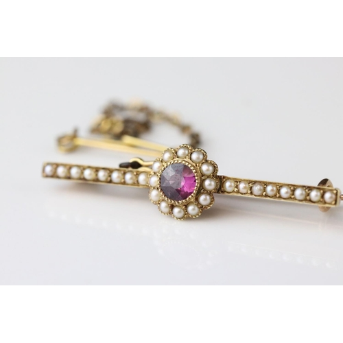 103 - Victorian/ Edwardian purple garnet and seed pearl 15ct yellow gold flower head bar brooch (with late...