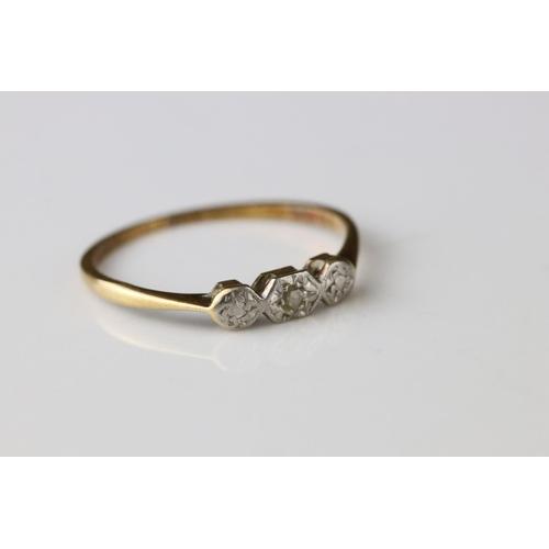 122 - Three stone diamond 18ct and platinum set ring, illusion settings, small eight cut and rose cut diam...