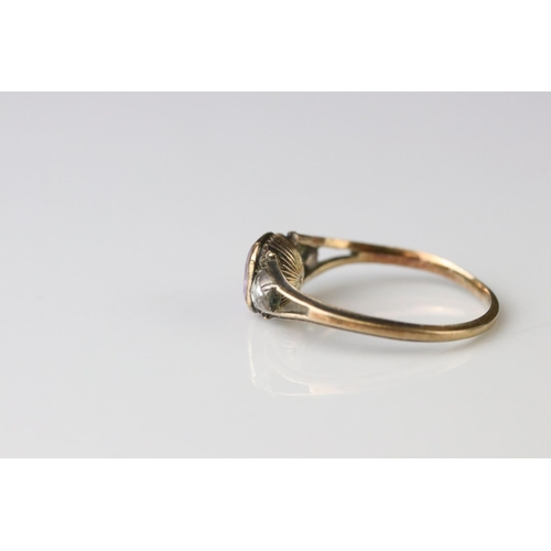 126 - 19th century diamond and lilac stone yellow metal ring, the central cushion cut lilac stone possibly...