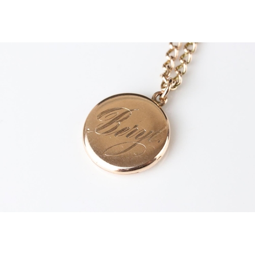 129 - 10ct yellow gold locket pendant engraved Beryl, containing hair to glazed compartment, on 9ct rose g...