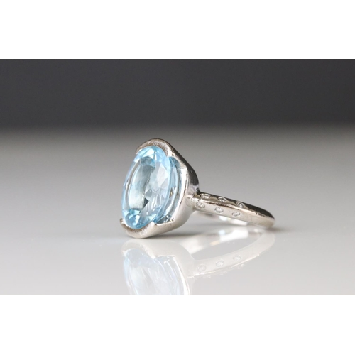 137 - Topaz and diamond ring, hallmarks rubbed, assessed as 18ct white gold, the oval mixed cut topaz meas...