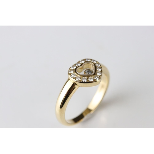 15 - Chopard Happy Diamonds diamond 18ct yellow gold heart ring, the heart shaped compartment containing ...