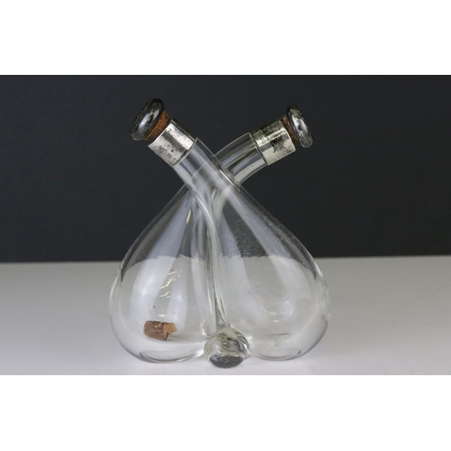179 - Silver Mounted Glass Cross-over Oil and Vinegar Bottles, with silver mounted original stoppers, make...