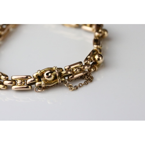 20 - Edwardian yellow metal fancy link bracelet, tongue and box patented clasp, safety chain, length appr...
