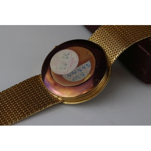 201 - A cased Omega gift set comprising of gents 18ct gold cased watch with 18ct gold strap and clasp toge...
