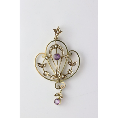 23 - Edwardian amethyst and seed pearl 9ct yellow gold pendant, openwork sinuous design, leaf and flower ...