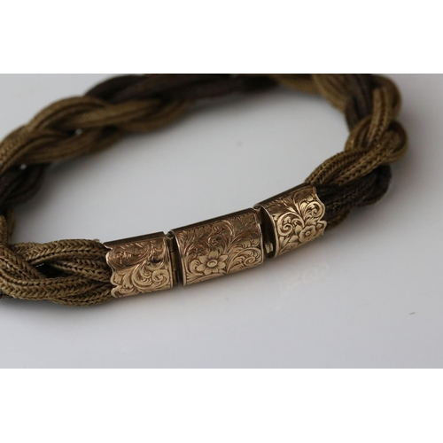 30 - Rope twist bracelet with Victorian unmarked rose gold clasp and collars, the tongue and box clasp wi...