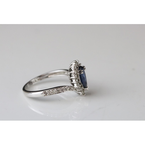 31 - Sapphire and diamond 18ct white gold ring, the pear shaped blue sapphire measuring approx 8mm x 4mm,...