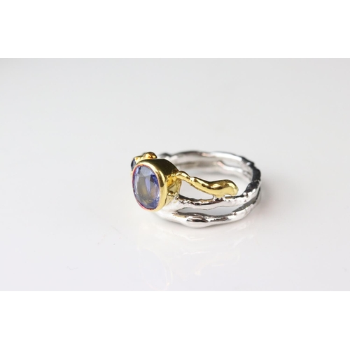 6 - Sapphire 18ct yellow and white gold ring, the principle oval mixed cut blue sapphire measuring appro...