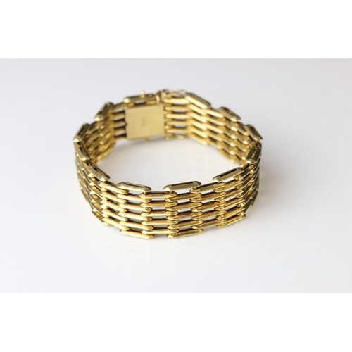 74 - 18ct yellow gold gate link style bracelet, tongue and box clasp, length approx 19cm