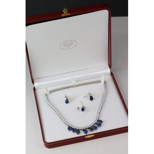 79 - Cubic ziconia silver suite comprising riviere drop necklace and drop earrings with post and butterfl...