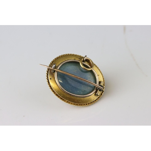 9 - Victorian pearl enamelled yellow metal Etruscan style oval pendant brooch, central cream pearl with ...
