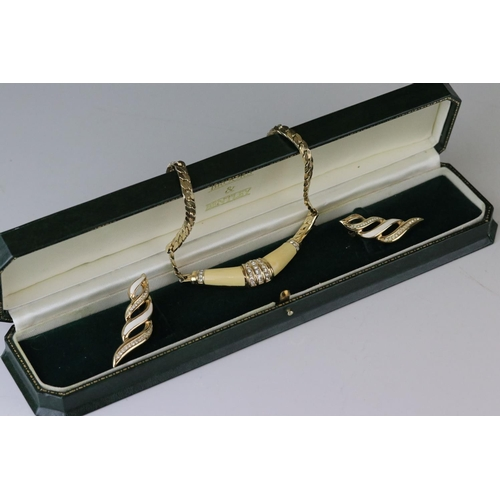 93 - Christian Dior enamel and paste gold plated necklace together with a pair of similar earrings