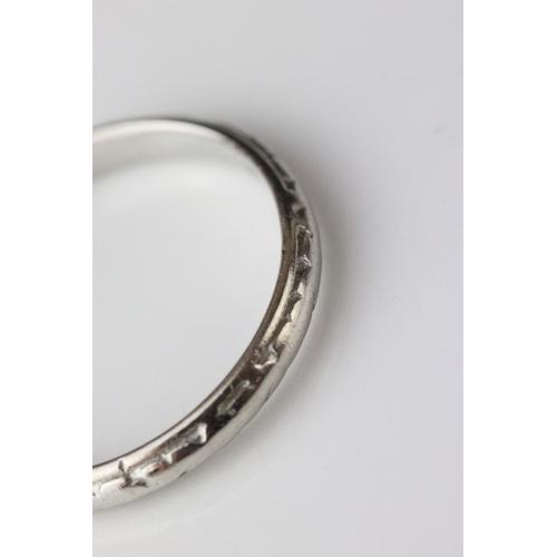 108 - Platinum wedding band, worn foliate design, width approx 2.5mm, ring size M