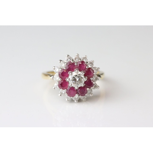 11 - Diamond and ruby three tier 18ct yellow gold and white gold set cluster ring, the principle diamond ...