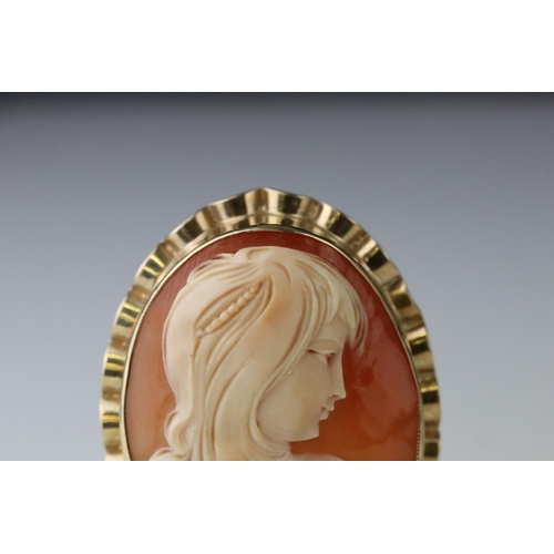 110 - Shell cameo 9ct yellow gold brooch, the cameo depicting a young girl in profile, signed verso, rub o...