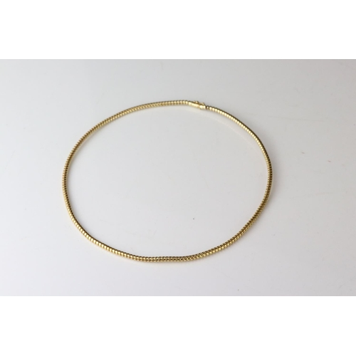 114 - Yellow metal choker neckace, snap clasp fastening, tests as a minimum of 14ct gold