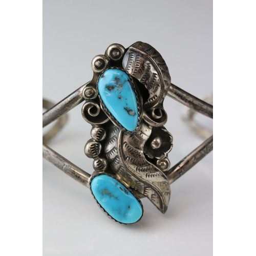 141 - Turquoise unmarked silver pendant necklace, four tumbled turquoise stones, silver leaf and berry mot...