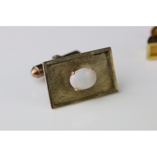 150 - Opal gold plated cufflink and tie clip set, the precious white opals displaying violet, blue, green,...