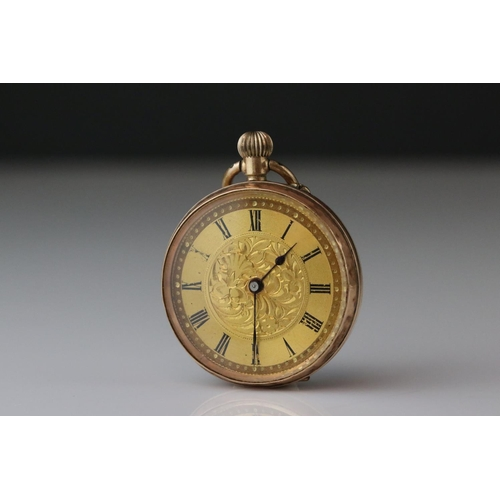 152 - 9ct gold cased top wind fob watch, bright cut foliate decoration to case, gold-colour dial, black Ro...