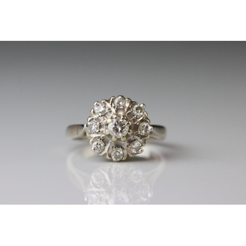 16 - Diamond 18ct white gold cluster ring, principle round brilliant cut diamond weighing approx 0.20 car...