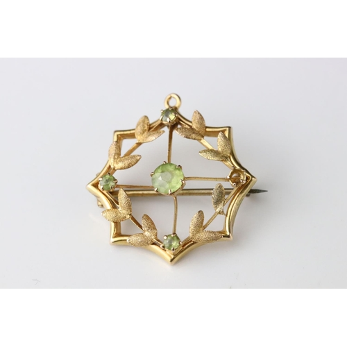 24 - Edwardian peridot unmarked yellow gold pendant brooch, assessed as 9ct gold, one peridot deficient; ...