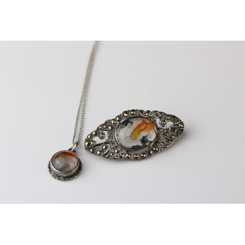 25 - Moss agate and full set marcasite silver marquise shaped brooch, the oval cabochon cut moss agate me...