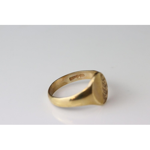 26 - 9ct yellow gold signet ring, oval blank cartouche with engraved scroll decoration, tapered shoulders...