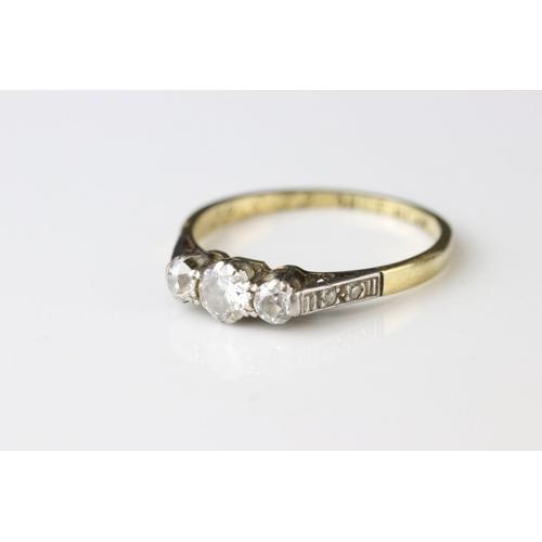 63 - Diamond 18ct yellow gold platinum set three stone ring, three graduated round brilliant cut diamonds...