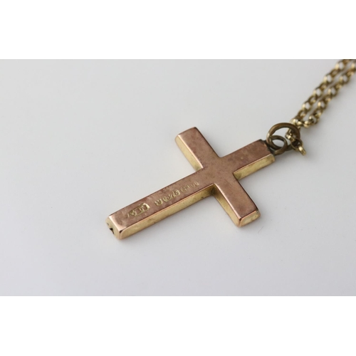 64 - 9ct rose gold cross pendant with engraved foliate decoration on later 9ct gold chain, replacement ba...