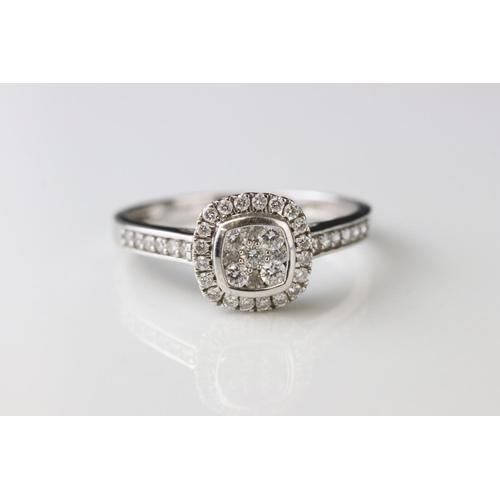 146 - Diamond cluster 18ct white gold ring, nine small round brilliant cut diamonds to central cluster, sq...