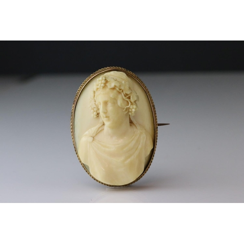 17 - Victorian ivory cameo unmarked yellow gold oval brooch, the ivory cameo depicting female bust with g...