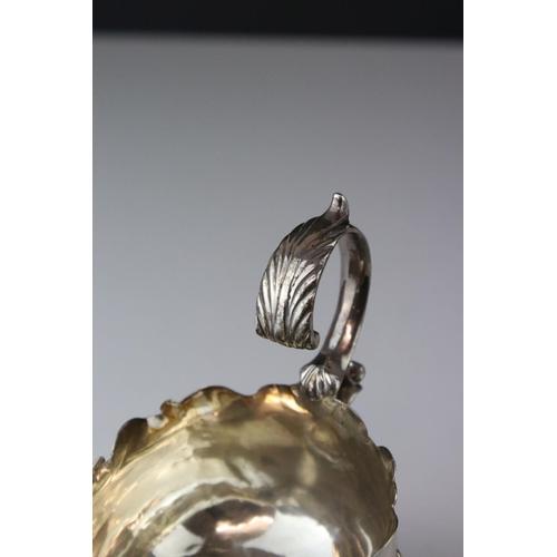 162 - George III silver sauce boat raised on three hoof feet with stylised foliate shoulders, engraved ini...