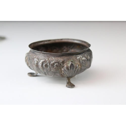 170 - Victorian silver open salt cellar raised on three hoof feet, repousse floral decoration to body, mis...