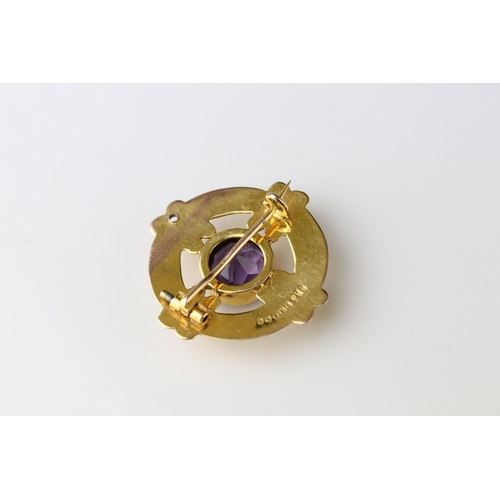 18 - Victorian amethyst 9ct gold brooch, the round mixed cut amethyst diameter approx 8mm, collet setting...
