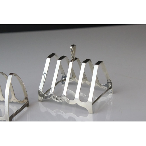 191 - Two silver five bar toast racks of arched form, makers Charles S Green & Co Ltd, Birmingham 1937 and...