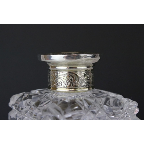 193 - Early Victorian silver topped cut glass scent bottle, monogramed lid with engraved floral and foliat...
