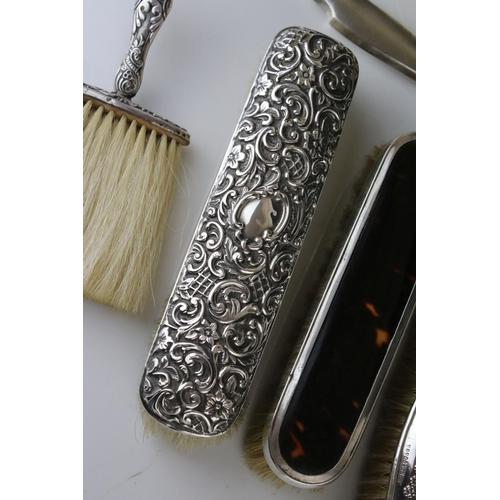 198 - Silver dressing table hand mirror together with silver backed brush, three silver backed clothes bru...