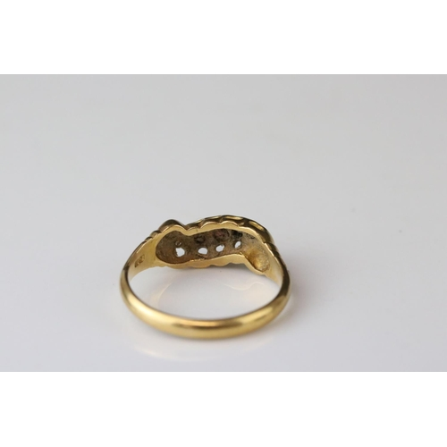 35 - Early 20th century ruby and diamond 18ct yellow gold scroll head ring, two small round mixed cut rub...
