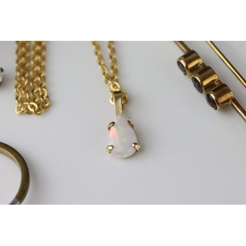 36 - Precious white opal 10ct yellow gold pendant on yellow metal chain, the pear-shaped cabochon cut opa...