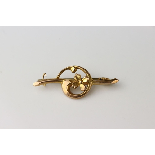 39 - Edwardian turquoise and seed pearl unmarked gold bar brooch; 9ct gold floral bar brooch together wit...