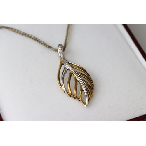 43 - Diamond 9ct yellow and white gold pendant necklace in the form of a leaf, five small round eight cut...