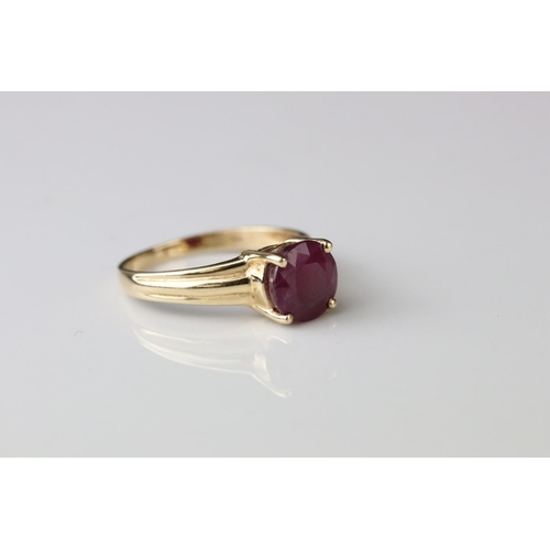 52 - Ruby 14ct yellow gold solitaire ring, four claw setting, textured shoulders, ring size P½
