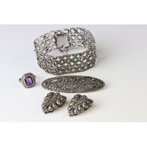 55 - Marcasite silver jewellery to include a panel bracelet, pierced form, tongue and box clasp with safe...