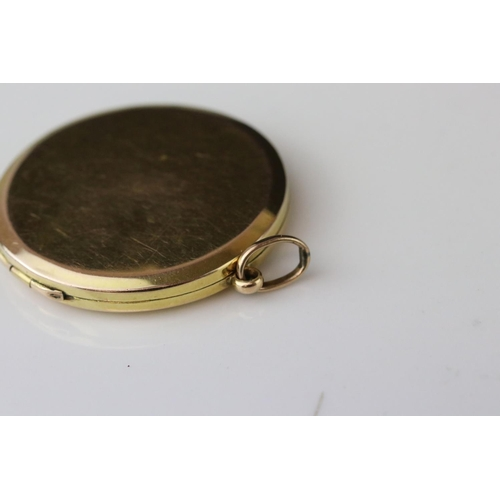 57 - 9ct gold circular locket, engraved monogram, diameter approx 3cm